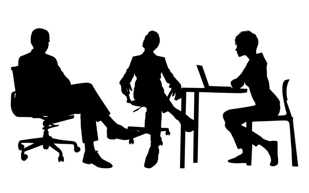 Silhouette of three office figures