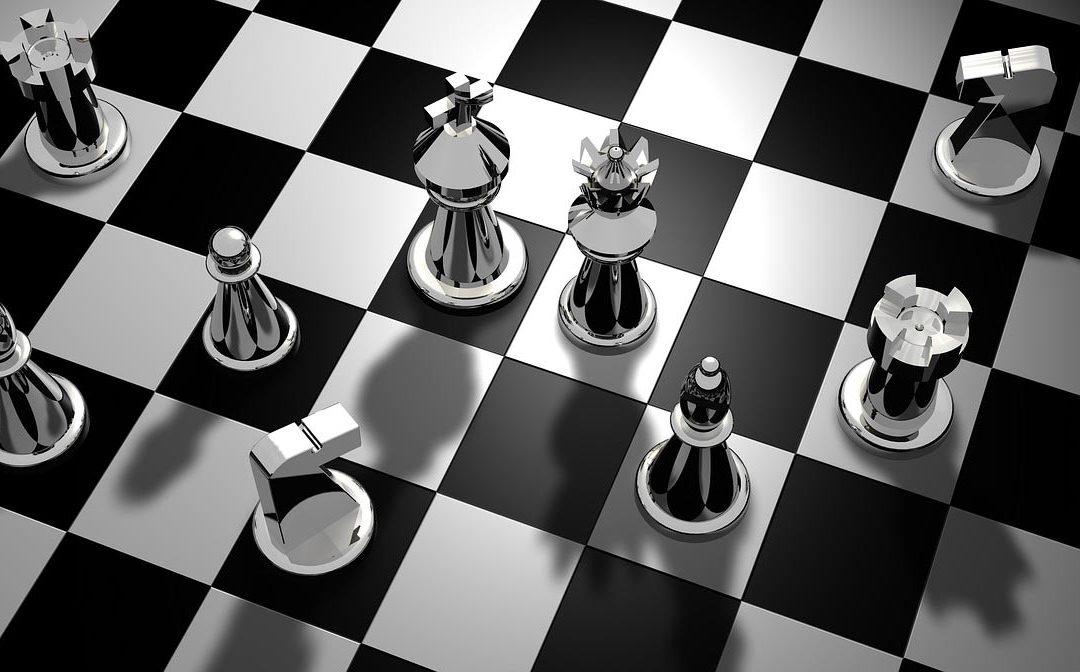 Chess pieces on a black and white checkered chess board