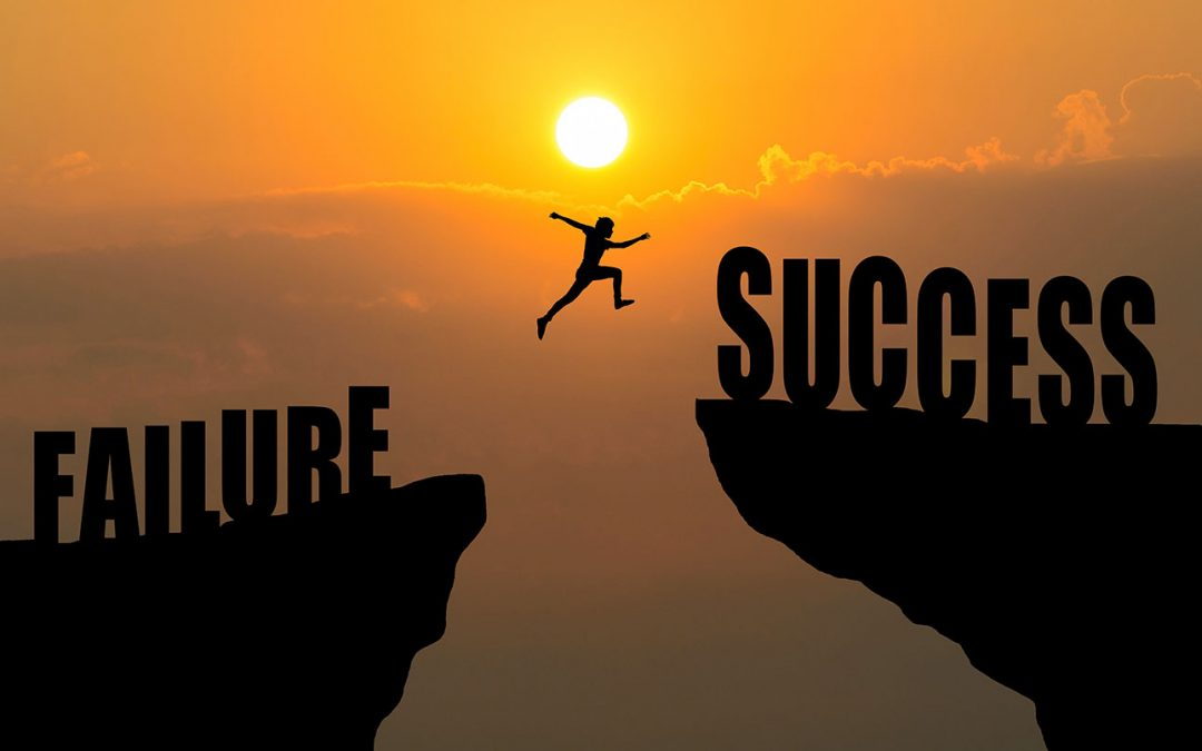 Silhouette of a figure jumping over a chasm, with the word Failure behind them and the word Success on the other side.